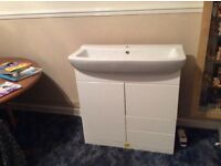 White large basin single tap and gloss finish cabinet