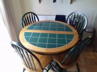 Extending table and four chairs