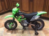 Child's motor cross style battery operated bike for sale
