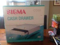 Sigma, brand new cash drawer with key, box still sealed.