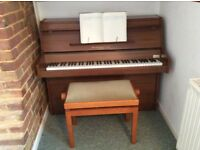 6 octave piano and stool annually professionally tuned - excellent condition. Buyer collects