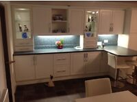 White wooden fitted kitchen units with appliances, excellent condition.