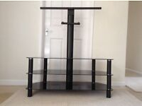 Black glass television table with detachable television bracket