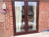 Mahogany Finish Patio Doors in excellent condition.