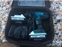Makita hp 457 li ion drill with two batteries charger and carry case