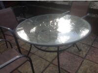 Round glass garden table and 4 chairs