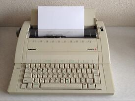 .Electronic Olympia Splendid portable typewriter with auto correct feature in as new condition
