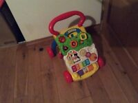 Vtech First Steps Baby Walker and musical detachable front. Excellent condition