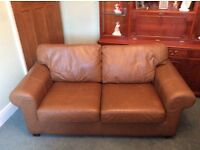 Tan leather two seater sofa with matching leather armchair in very good condition