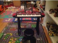Kids keyboard on stand with stool