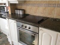 Kitchen cupboards and electric hob