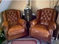 2 leather DFS Oskar wingback chairs