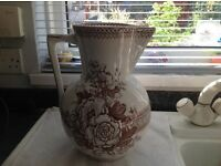 Antique jug in cream and brown