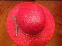 Ladies strawberry red hat with neat trim around.