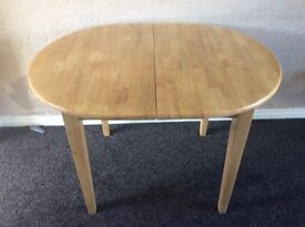 Extending dining table light wood
