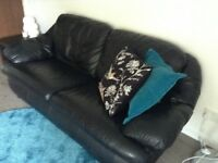 Black two seater sofa.