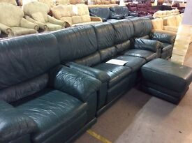 Green leather sofa with chairs and footstool