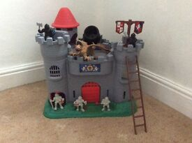 Castle playset with knights and dragon.