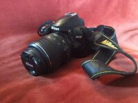 Nikon D3000 DSLR with 2 lenses, charger and bag