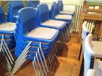 60 blue plastic stacking chairs with padded seat cushions in reasonable condition