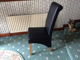 Dining chair x 4 (new condition) in black leather effect fabric.