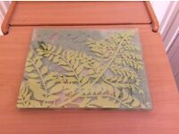 Lovely tempered glass place mats with green leaf design.
