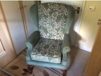 High back winged arm chair in green fabric