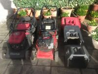2 lawn mowers in need of attention or for spairs. Engines very good. 3 assorted mower boxes