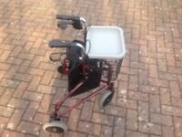 Invacare three-wheel Rollator. New condition. Used once. Feel free to ask questions