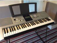 Yamaha keyboard with stand and 2 books