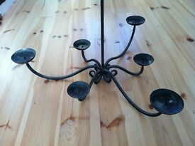 Wrought iron chandelier candle-holder. Good condition.
