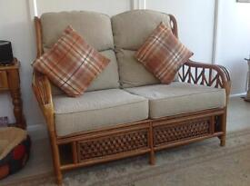 Three piece cane furniture suite & matching coffee table.