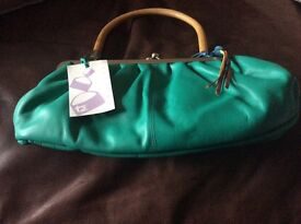 Tula Gorgeous green leather handbag. Never used still has tag on it.
