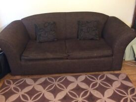 Sofa bed with 2 cushions & rug to give away for free