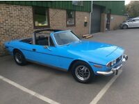 Triumph Stag 3.0 Litre V8 softop (no hardtop) in light powder blue reminiscent of a 1960's TR4.