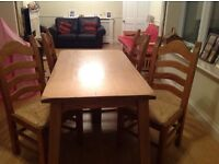 Solid oak dinning room table and four chairs