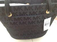 Brand new Michael kors handbag. Black with Mk logo
