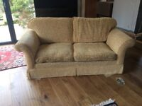 Two seater sofa bed- decent condition