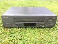 Sharp video cassette player/ recorder