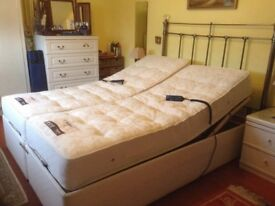 Electrically adjustable beds by Dreams.Can be double or 2 singles