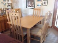 Extendable dining room table and 6 chairs in the style of Rennie McIntosh