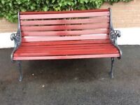 Decorative garden bench. 4 foot length. 24 wooden slates Maroon&grey colour Antique cast iron sides.