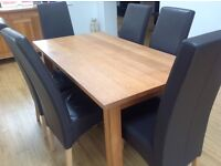 Solid oak dining table with 6 brown leather chairs, matching sideboard and lamp table