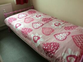 Girl's pink single bed