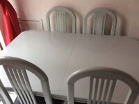 Grey extendable dining table and chairs