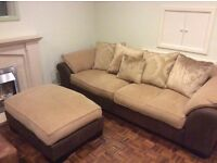 Comfy beige fabric sofa with brown leather sides with footstool
