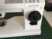 Sewing machine over locker garment steamer