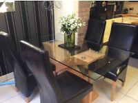 Moden glass dining table and 4 chairs