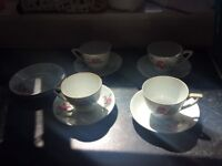Set of white china cups and plates
