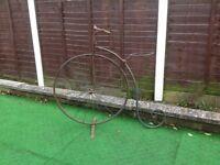 "Planter "" rusty penny farthing bike"